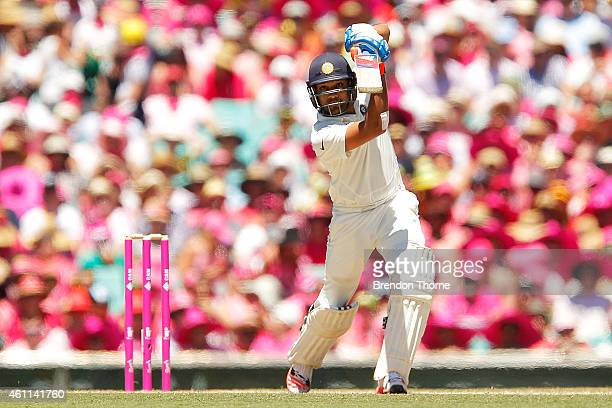 Rohit Sharma of India plays a cover drive during day three of the Fourth Test match between Australia and India at Sydney Cricket Ground on January 8...