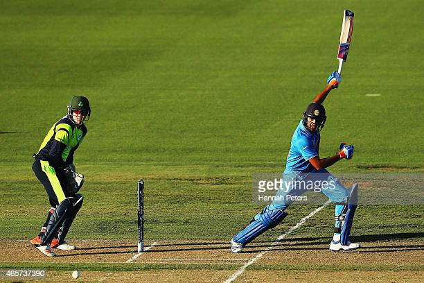 Rohit Sharma of India plays the ball away for four runs during the 2015 ICC Cricket World Cup match between Ireland and India at Seddon Park on March...