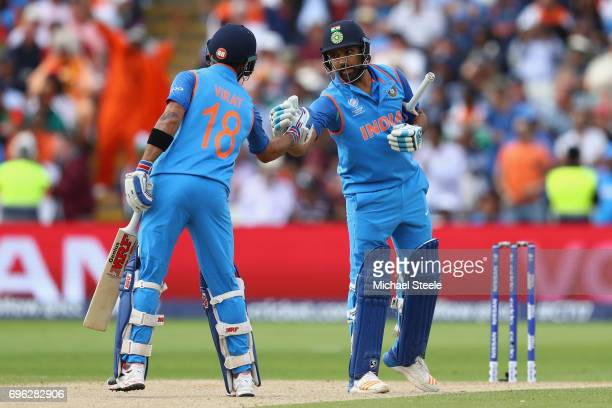 Rohit Sharma of India shakes hands with captain Virat Kohli of India as they reach their 150 partnership during the ICC Champions Trophy SemiFinal...