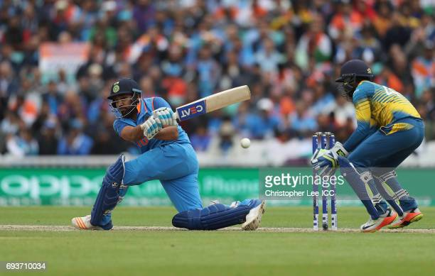 Rohit Sharma of India sweeps the ball past Niroshan Dickwella of Sri Lanka during the ICC Champions Trophy Group B match between India and Sri Lanka...