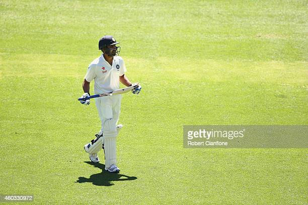 Rohit Sharma of India walks from the ground after he was dismissed during day four of the First Test match between Australia and India at Adelaide...