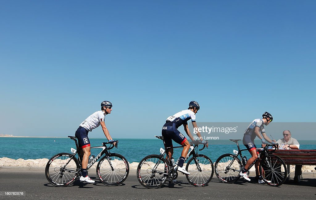 Roiders from the IAM Cycling team sign on at the start of stage three of the Tour of Qatar from Al Wakra to Mesaieed on February 5, 2013 in Doha, Qatar.