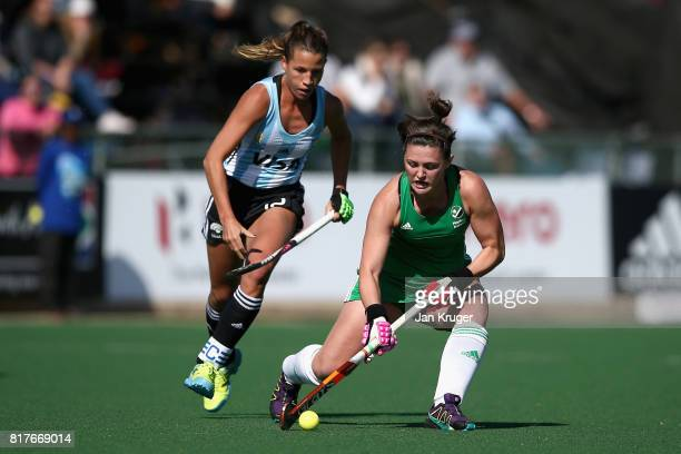 Roisin Upton of Ireland and Delfina Merino of Argentina battle for possession during the Quarter Final match between Argentina and Ireland during the...