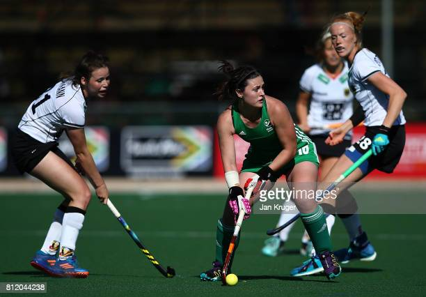 Roisin Upton of Ireland looks to pass under pressure from Amelie Wortmann of Germany at Wits University on July 10 2017 in Johannesburg South Africa
