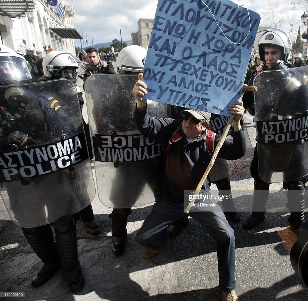 Roit police has blocked a road outside Greece's parliament during a protest on February 20, 2013 in Athens, Greece. Unions have launched general strike against austerity measures in Greece, amid predictions unemployment in the crisis-hit country will reach 30 percent this year.