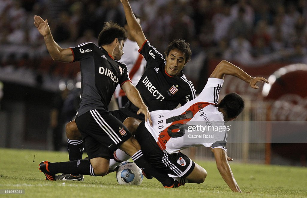 Rojas of River Plate fights for the ball with Rodrigo Braña and Gelabert of Estudiantes during the match between River Plate and Estudiantes of Torneo Final 2013 on February 17, 2013 in Buenos Aires, Argentina.