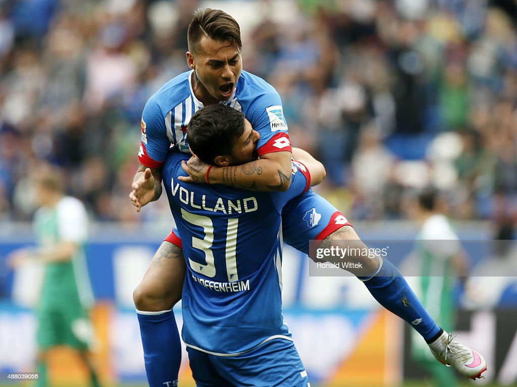Rojas Vargas of Hoffenheim celebrates after scoring his team's first goal with Kevin Volland during the Bundesliga match between 1899 Hoffenheim and...