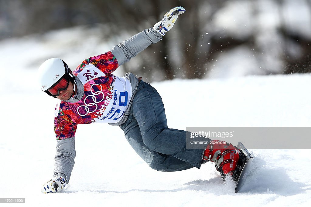 <a gi-track='captionPersonalityLinkClicked' href=/galleries/search?phrase=Rok+Flander&family=editorial&specificpeople=869981 ng-click='$event.stopPropagation()'>Rok Flander</a> of Slovenia competes in the Snowboard Men's Parallel Giant Slalom 1/8 finals on day twelve of the 2014 Winter Olympics at Rosa Khutor Extreme Park on February 19, 2014 in Sochi, Russia.