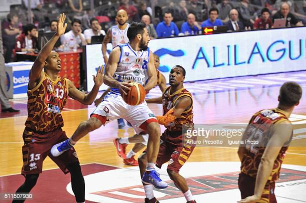 Rok Stipcevic of Banco di Sardegna competes with Josh Owens and Mike Green of Umana during the LegaBsaket Serie A match between Reyer Umana Venezia...