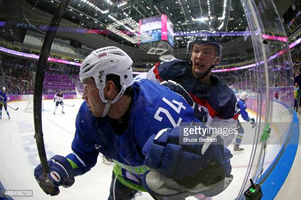 Rok Ticar of Slovenia collides with Martin Marincin of Slovakia in the second period during the Men's Ice Hockey Preliminary Round Group A game on...