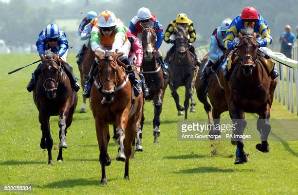 Roker Park ridden by jockey Pat Cosgrave stays ahead of second place Befortyfour ridden by jockey Philip Robinson to win The Ebf Man Erf Maiden...