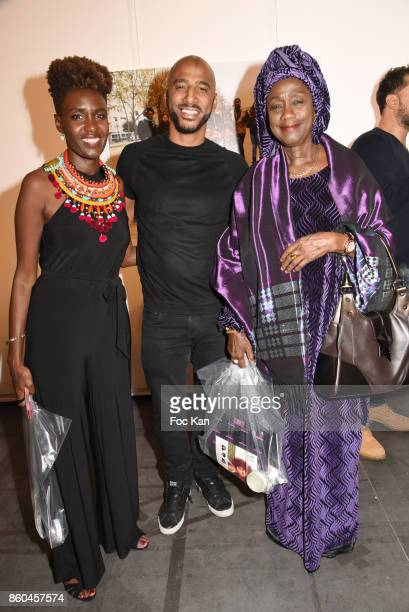 Rokhaya Diallo rap artist/actor Stomy Bugsy and Rokhaya Diallo's mother attend the 'Afro' Rokhaya Diallo and photographer Brigitte Sombie Exhibition...
