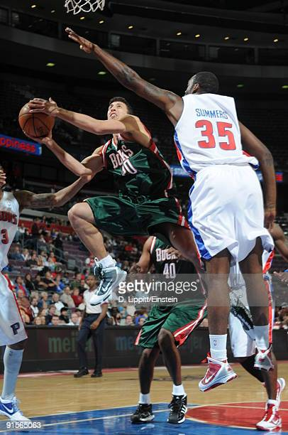 Roko Ukic of the Milwaukee Bucks goes up for a shot attempt against DaJuan Summers of the Detroit Pistons in a preseason game at the Palace of Auburn...