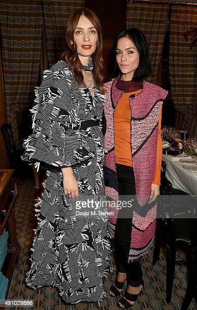 Roksanda Ilincic and Leigh Lezark attend the Roksanda Ten Year Anniversary Dinner at Caviar Kaspia on October 2 2015 in Paris France