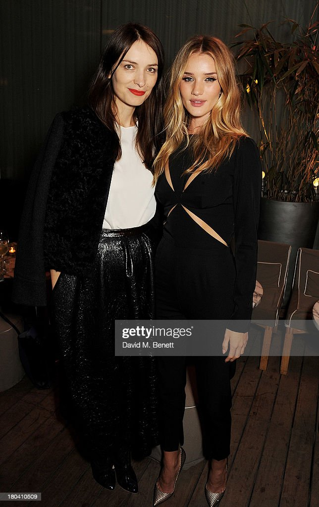 Roksanda Ilincic (L) and <a gi-track='captionPersonalityLinkClicked' href=/galleries/search?phrase=Rosie+Huntington-Whiteley&family=editorial&specificpeople=2244343 ng-click='$event.stopPropagation()'>Rosie Huntington-Whiteley</a> attend the ELLE Magazine drinks reception celebrating London Fashion Week SS14 at the Sanderson Hotel on September 12, 2013 in London, England.