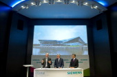 Roland Busch Member of the Siemens Managing Board and CEO of the sector Infrastructure Cities Peter Loescher President Chief Executive Officer of...