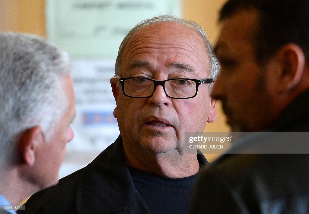 Roland Cassone (R), an alleged member of a Corso-Marseillais organized crime group, speaks with people as he takes a break during a court hearing in a trial involving a Parisian illegal gambling ring known as 'Concorde', at the courthouse in Marseille, on May 27, 2013. Cassone will be tried alongside 19 defendants accused of illegal gambling, extortion, and money laundering.