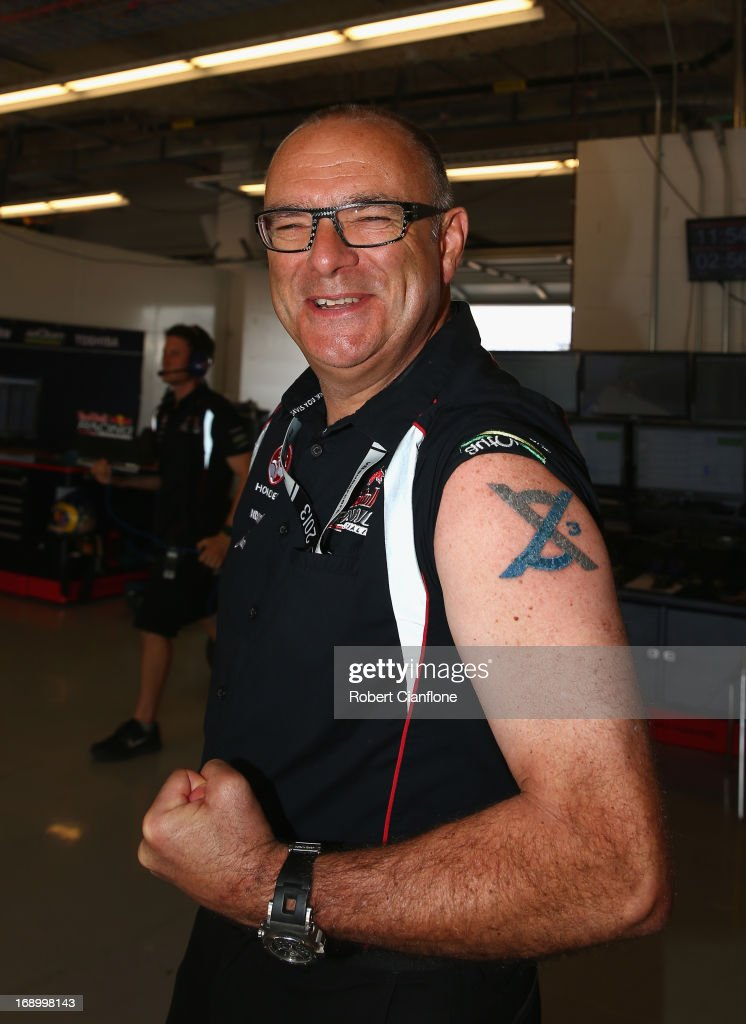 Roland Dane, team principal for Triple Eight Engineering shows off his tattoo prior to the Austin 400, which is round five of the V8 Supercar Championship Series at Circuit of The Americas on May 18, 2013 in Austin, Texas.