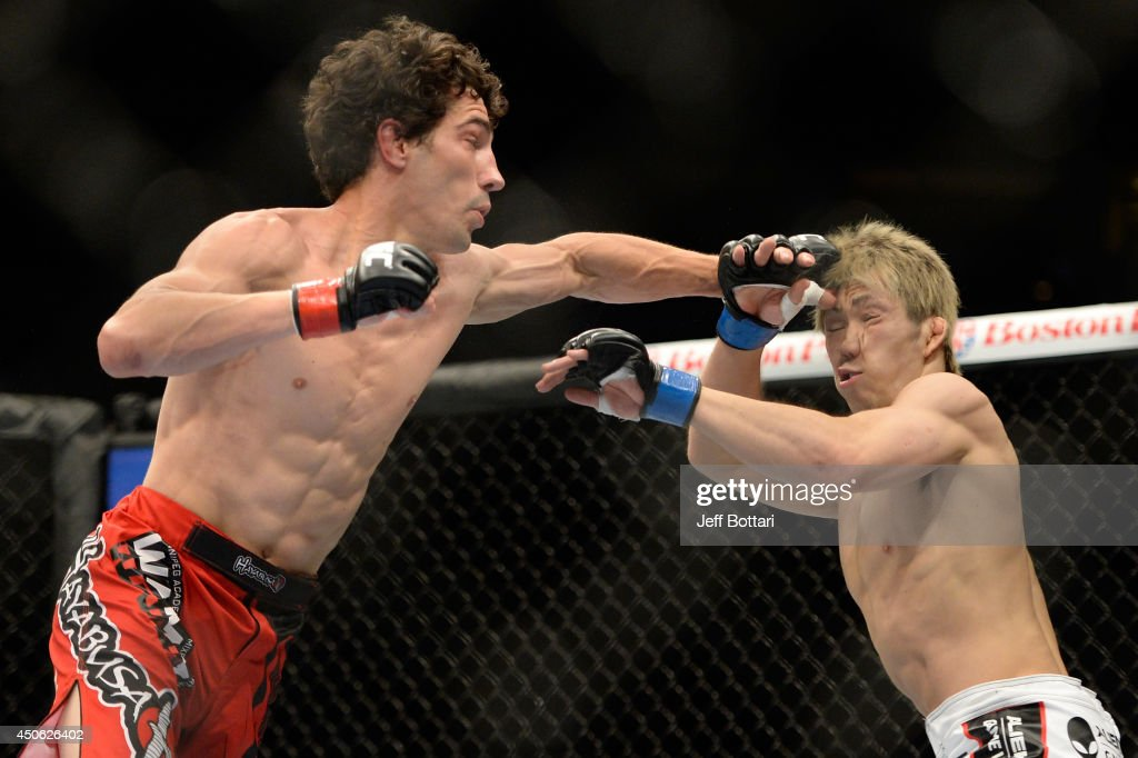Roland Delorme punches Michinori Tanaka during the UFC 174 event at Rogers Arena on June 14, 2014 in Vancouver, British Columbia, Canada.