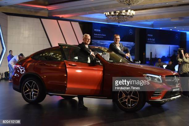 Roland Folger Managing Director and CEO of India Operations and Michael Jopp VP Sales and Marketing MercedesBenz India pose with Mercedes AMG GLC 43...