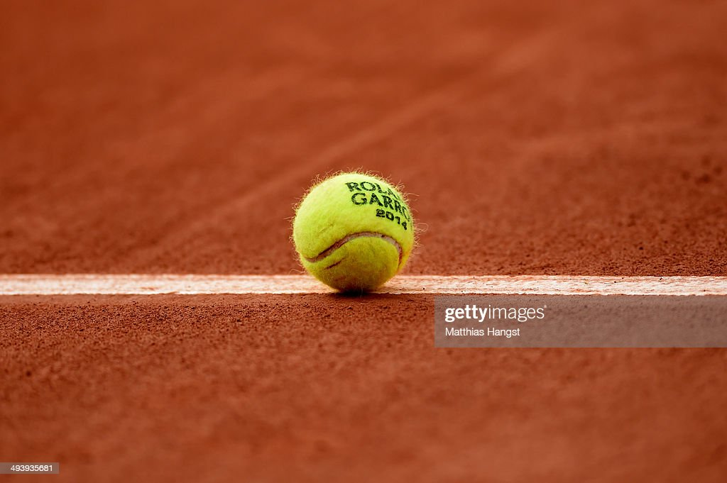 Roland Garros tennis ball rests on one of the court lines during day two of the French Open at Roland Garros on May 26 2014 in Paris France
