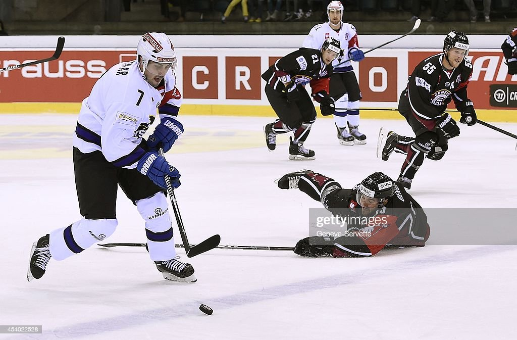 Roland Gerber #15 of Geneve-Servette and <a gi-track='captionPersonalityLinkClicked' href=/galleries/search?phrase=Klemen+Pretnar&family=editorial&specificpeople=10891941 ng-click='$event.stopPropagation()'>Klemen Pretnar</a> # 7 of Villach SV are fighting for the puck during the Champions Hockey League group stage game between Geneve-Servette and Villach SV on August 23, 2014 in Geneva, Switzerland.