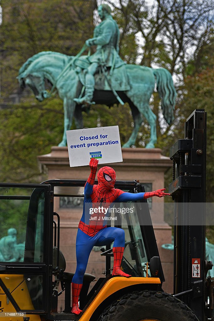 Roland Gulliver, associate director of the Edinburgh International Book Festival, dressed in costume as comic strip character Spiderman, helps to put finishing touches to the Edinburgh Book Festival Site on July 29, 2013 in Edinburgh, Scotland. Edinburgh International Book Festival 2013, which opens next week, is celebrating its 30th anniversary year. The event will see over 800 authors attending, it will also be celebrating graphic novels, comics and the people who create them in Stripped, a series of 40 events within the main programme.