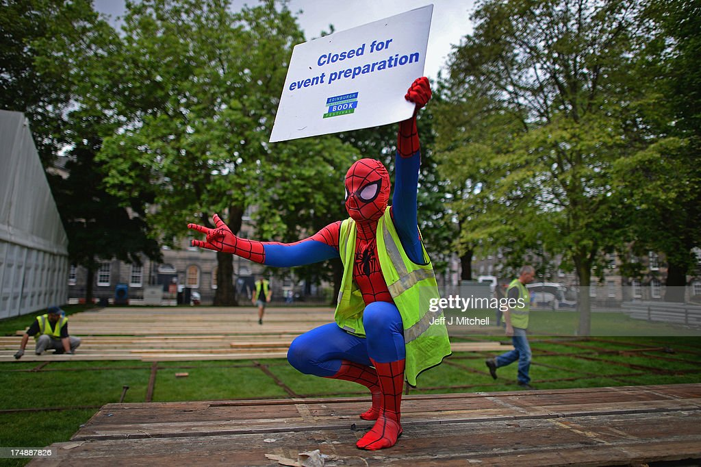 Roland Gulliver, associate director of the Edinburgh International Book Festival, dressed in costume as comic book character Spiderman, helps to put finishing touches to the Edinburgh Book Festival Site on July 29, 2013 in Edinburgh, Scotland. Edinburgh International Book Festival 2013, which opens next week, is celebrating its 30th anniversary year. The event will see over 800 authors attending, it will also be celebrating graphic novels, comics and the people who create them in Stripped, a series of 40 events within the main programme.