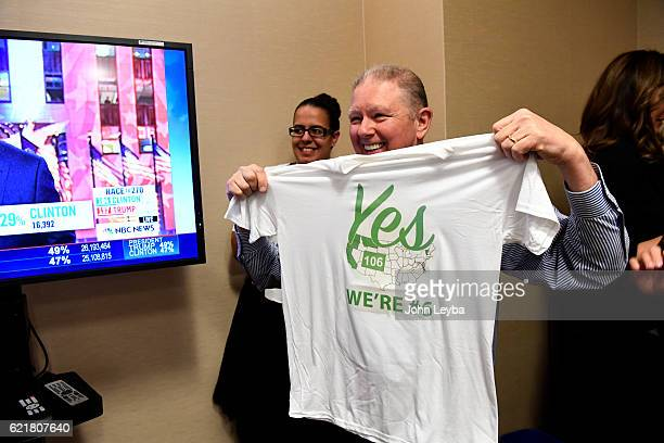 Roland Halpern holds up a shirt after finding out that Prop 106 has passed which would allow terminally ill patients to take lifeending...