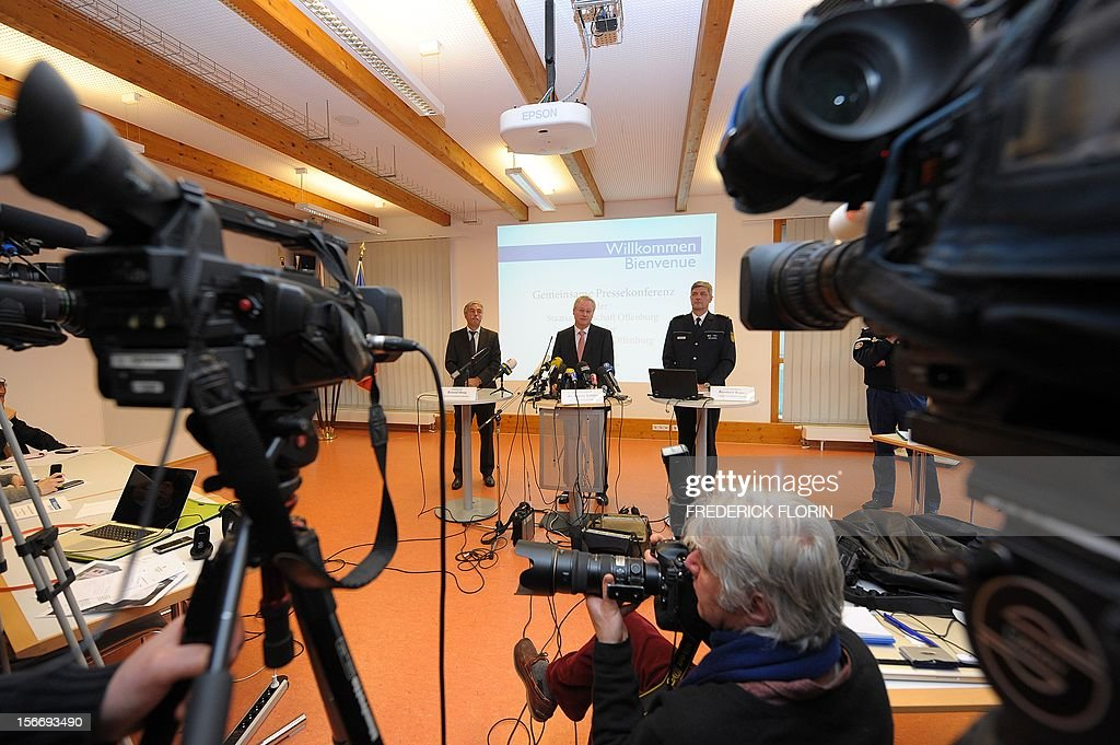 Roland Haug, leader of Offenburg's criminal police, Herwig Schafer, head of the Public Prosecutor's Department in Offenburg, and Reinhard Renter, leader of the police department in Offenburg deliver a press conference in Offenburg, southern Germany, on November 19, 2012, to comment on a case in which a kidnapped French girl was found alive in a car boot in Germany. Chloe Rodriguez, whose disappearance from her home in southern France sparked a nationwide hunt, was found on November 16, 2012 in the boot of a car in Oppenau near Offenburg. The driver of the car has been held by police on suspicion of kidnap. AFP PHOTO / FREDERICK FLORIN
