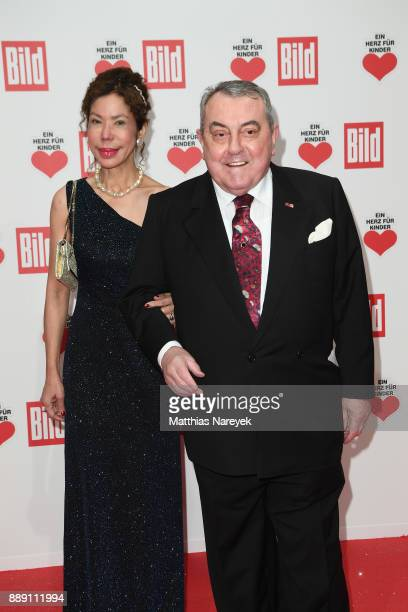 Roland Hetzer and his wife Magdalena attend the Ein Herz Fuer Kinder gala on at Studio Berlin Adlershof on December 9 2017 in Berlin Germany