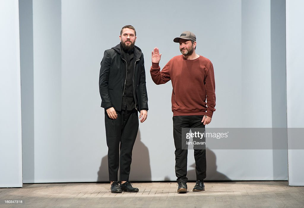 Roland Hjort and Jonas Bladmo appear on the runway after the Whyred fashion show at Mercedes-Benz Stockholm Fashion Week Autumn/Winter 2013 at Berns on January 29, 2013 in Stockholm, Sweden.