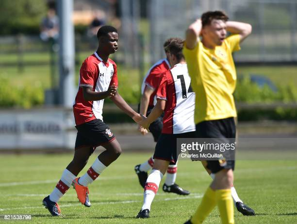 Roland Idowu of Southampton celebrates after equalising for his side during the NI Super Cup junior section game between Southampton and County...