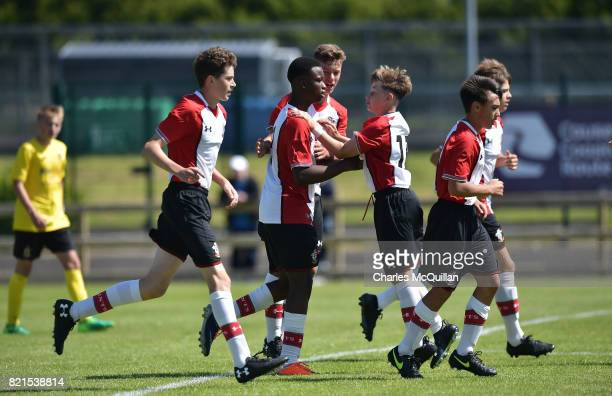 Roland Idowu of Southampton celebrates with team mates after equalising for his side during the NI Super Cup junior section game between Southampton...