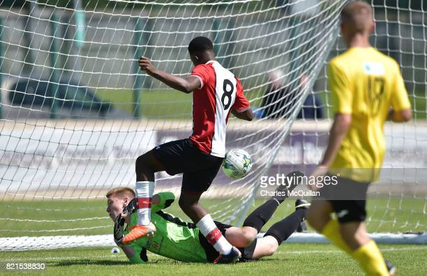 Roland Idowu of Southampton scores past Rian Lennon of County Antrim during the NI Super Cup junior section game between Southampton and County...