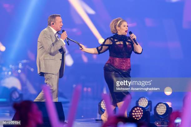 Roland Kaiser and Maite Kelly perform during the show 'Das Internationale Schlagerfest' at Westfalenhalle on October 21 2017 in Dortmund Germany