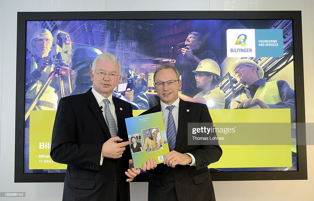 Roland Koch (L), Chairman of the Executive Board at Bilfinger SE, and Joachim Mueller, chief financial officer Bilfinger SE, pose after the annual press conference to present the 2012 financial results on March 13, 2013 in Mannheim, Germany. Bilfinger SE announced an operating profit at record level.