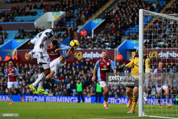 Roland Lamah of Swansea City heads in their first goal past Brad Guzan of Aston Villa during the Barclays Premier League match between Aston Villa...