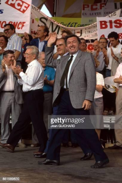 Roland Leroy Georges Marchais et André Lajoinie à la Fête de l'Humanité le 13 septembre 1987 à La Courneuve France
