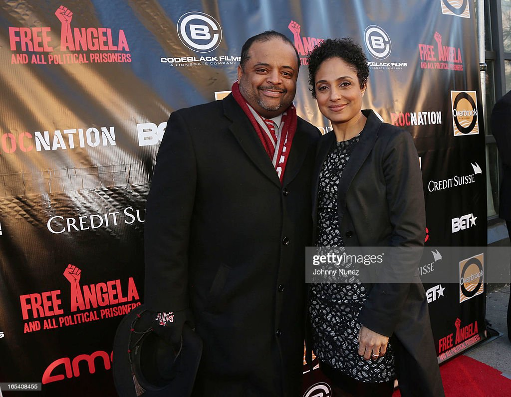 <a gi-track='captionPersonalityLinkClicked' href=/galleries/search?phrase=Roland+Martin&family=editorial&specificpeople=5490103 ng-click='$event.stopPropagation()'>Roland Martin</a> and Shola Lynch attend the 'Free Angela and All Political Prisoners' New York Premiere at The Schomburg Center for Research in Black Culture on April 3, 2013 in New York City.