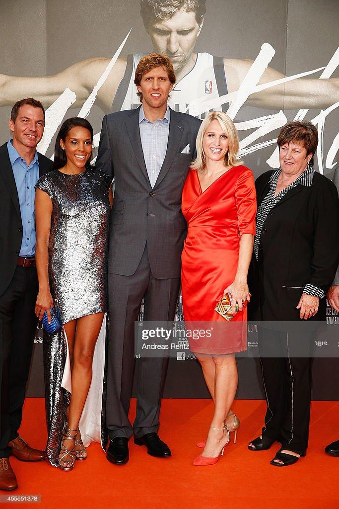Roland Mayer, Jessica Nowitzki with Dirk Nowitzki, sister Silke Nowitzki and mother Helga Nowitzki attend the premiere of the film 'Nowitzki. Der Perfekte Wurf' at Cinedom on September 16, 2014 in Cologne, Germany.