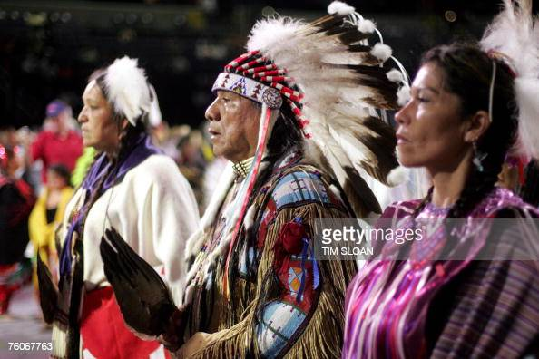 Roland McCook and his daughter Lisa represent the Ute tribe from Utah during an adult exhibition dance during the National Powwow 12 August 2007 at...