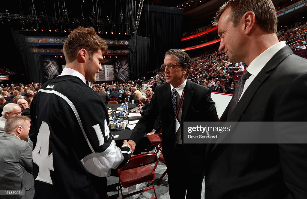 Roland McKeown greets General Manager Dean Lombardi and Rob Blake after being selected 50th overall by the Los Angeles Kings during the 2014 NHL Entry Draft at Wells Fargo Center on June 28, 2014 in Philadelphia, Pennsylvania.