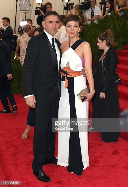 Roland Mouret and Maggie Gyllenhaal attend the 'China Through The Looking Glass' Costume Institute Benefit Gala at Metropolitan Museum of Art on May...