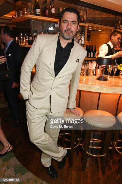 Roland Mouret attends a combined celebratory VIP dinner marking The Ivy's centenary year and 150 years of Harper's Bazaar sponsored by PerrierJouet...