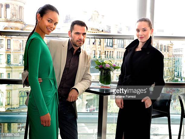 Roland Mouret with models Lizzy Burden and Leanne Vasko attend the preview of the Roland Mouret Autumn Winter Collection at Selfridges on July 13...