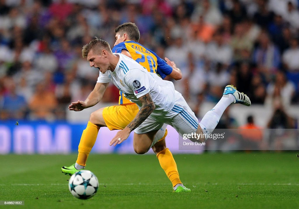 Roland Sallai of Apoel FC fouls Toni Kroos of Real Madrid during the UEFA Champions League group H match between Real Madrid and APOEL Nikosia at Estadio Santiago Bernabeu on September 13, 2017 in Madrid, Spain.