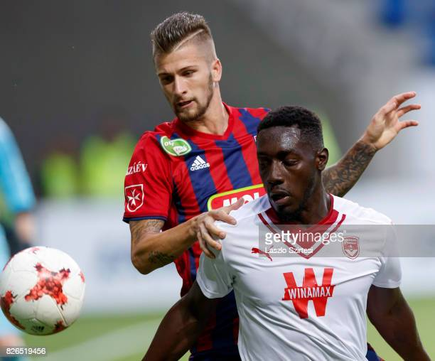 Roland Szolnoki of Videoton FC competes for the ball with Alexandre Mendy of FC Girondins de Bordeaux during the UEFA Europa League Third Qualifying...
