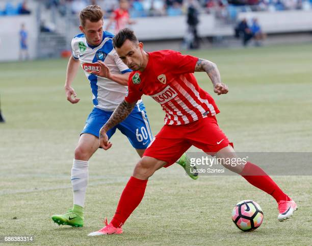 Roland Ugrai of DVTK covers the ball from Kevin Korozman of MTK Budapest during the Hungarian OTP Bank Liga match between MTK Budapest and DVTK at...