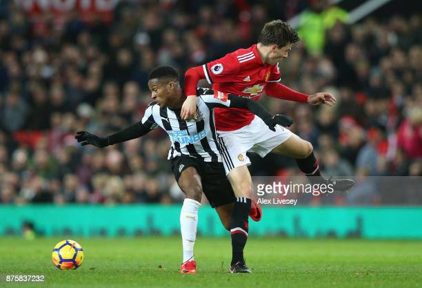 Rolando Aarons of Newcastle United and Victor Lindelof of Manchester United in action during the Premier League match between Manchester United and...